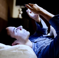 tablet of smartphone in bed