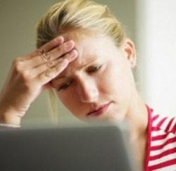 hoofdpijn vrouw laptop